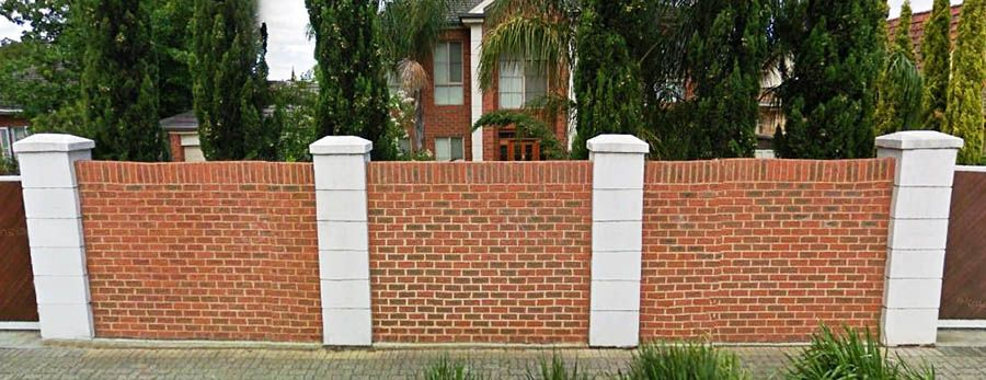 Brick fence in a row Fence design, Building a brick wall