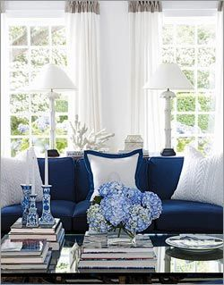 navy blue couch and white drapes #living_room