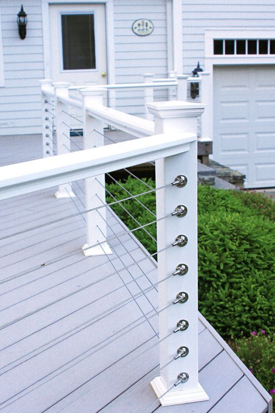 Simple White Posts And Horizontal Cable Railing For A Beachside Cottage Cable Railing Deck Patio Railing Deck Railing Design