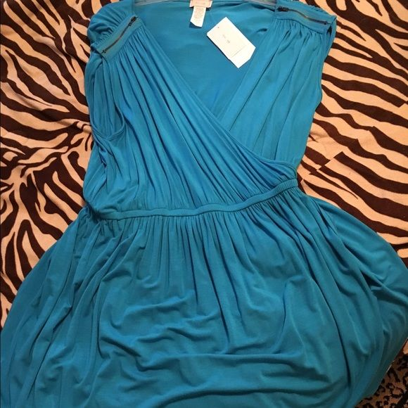 Plus size turquoise phone wrap sexy mini dress This dress is super cute and super flattering plunging crossed neckline elastic waist and cute faux wrap bottom to the knee. Trendy zippers at the shoulders size 1X new with tags Dresses Mini