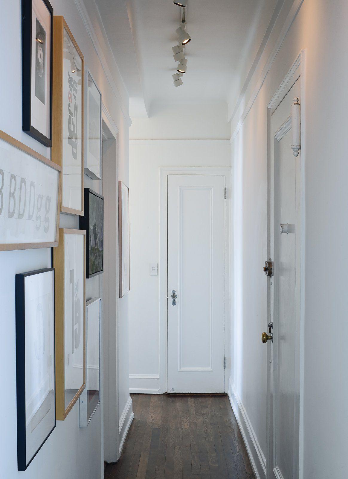 Narrow hallway decor  A narrow hallway typical of prewar apartments doubles as an art