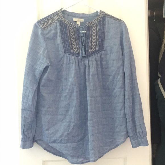 J. Crew chambray tassel tie blouse Cheaper shipping on ♏️ercari! Perfect for a beach day or just with black leggings. Washed but never worn! Truly gorgeous detail and sad to part with it. Selling because it's a little big on me. 99% cotton, 1% spandex. Open to offers but no trades or low balling. J. Crew Tops Blouses