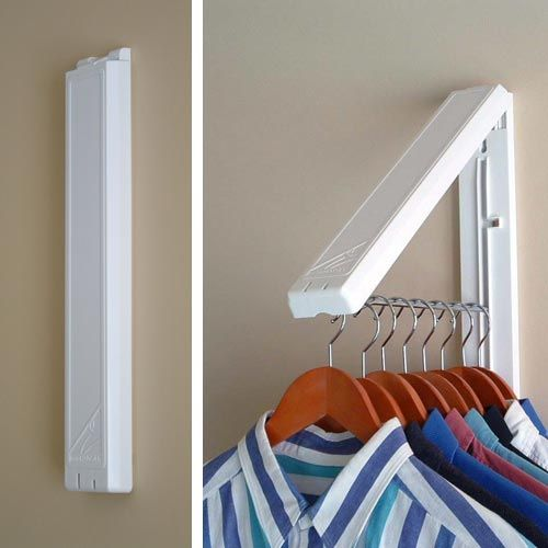 can fold them away the instahanger laundry room organizer stays flat against the wall out of the way when not in use and folds out to provide 12 inches of