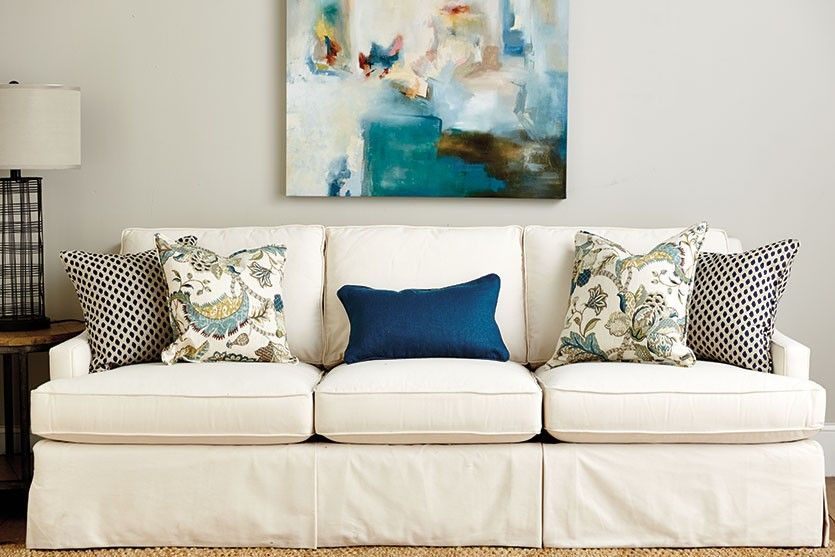 Blue Throw Pillows On An Off White Couch