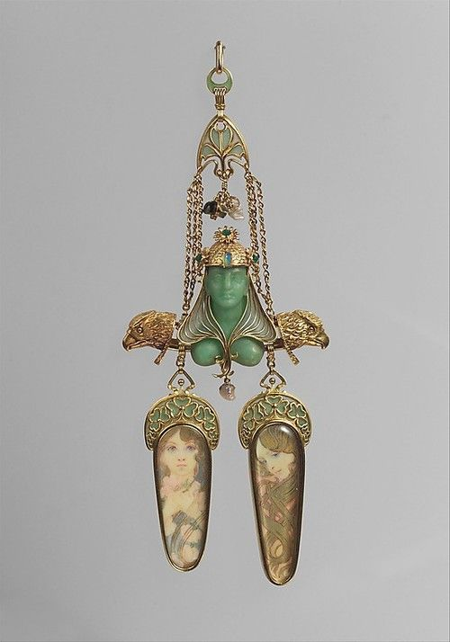 Pendant, ca. 1900  |Gold, enamel, mother-of-pearl, opal, emerald, colored stones, gold paintThis remarkable pendant marks a high point in the three-year partnership of Georges Fouquet, the renowned French jeweler, and Alphonse Mucha, the Czech graphic artist whose work has become synonymous with Art Nouveau style.