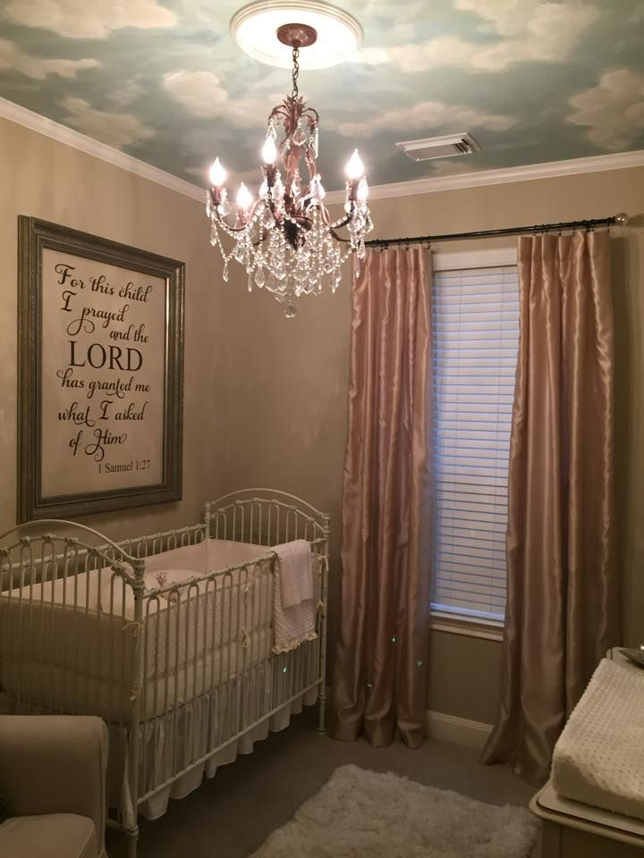 Neutral Nursery With Chandelier Clouds On Ceiling