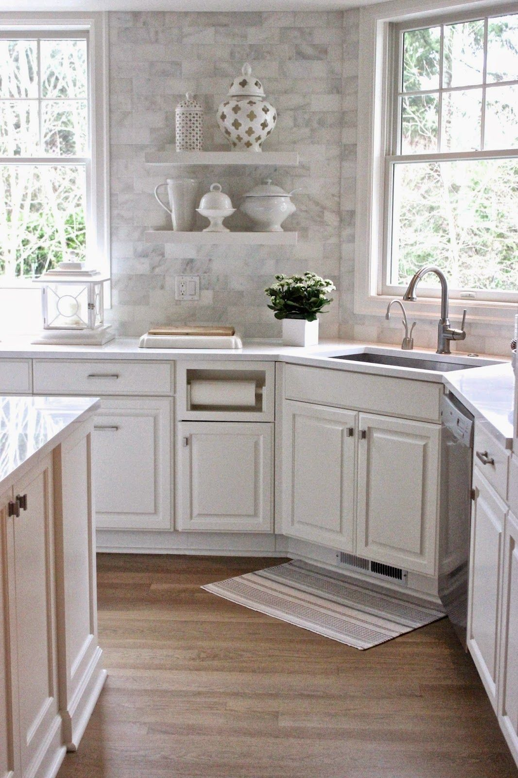 White Quartz countertops and the backsplash is Carrera Marble subway ...