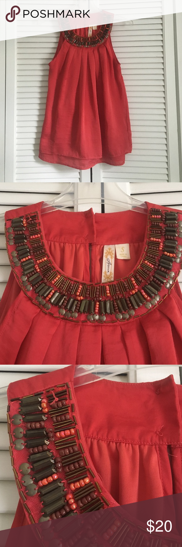 Bronze Detail Red Top Beautiful, dressy red tank with bronze beading detail at the neckline. The shirt is in great condition with one errant string as pictured 🎀 Adiva Tops Tank Tops