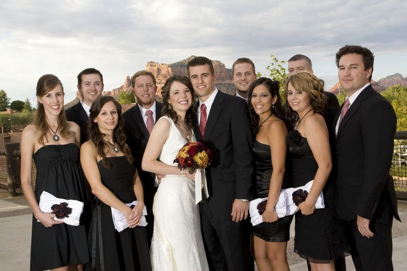 Another wedding party carrying clutches decorated with a floral ...