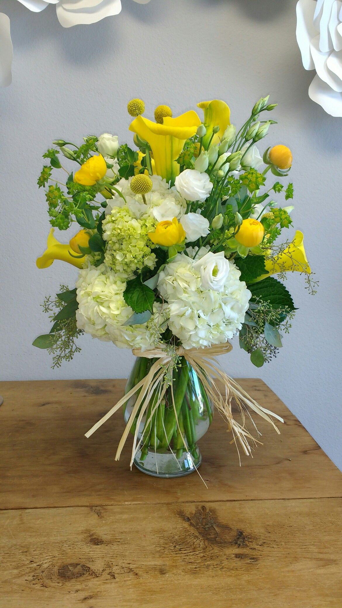 Yellow floral arrangement using calla lilies crespidia