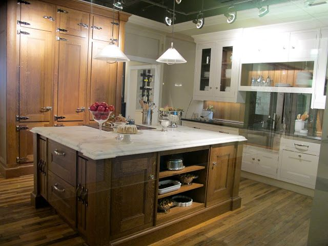 mix of wood and painted cabinets. marble counter top on island