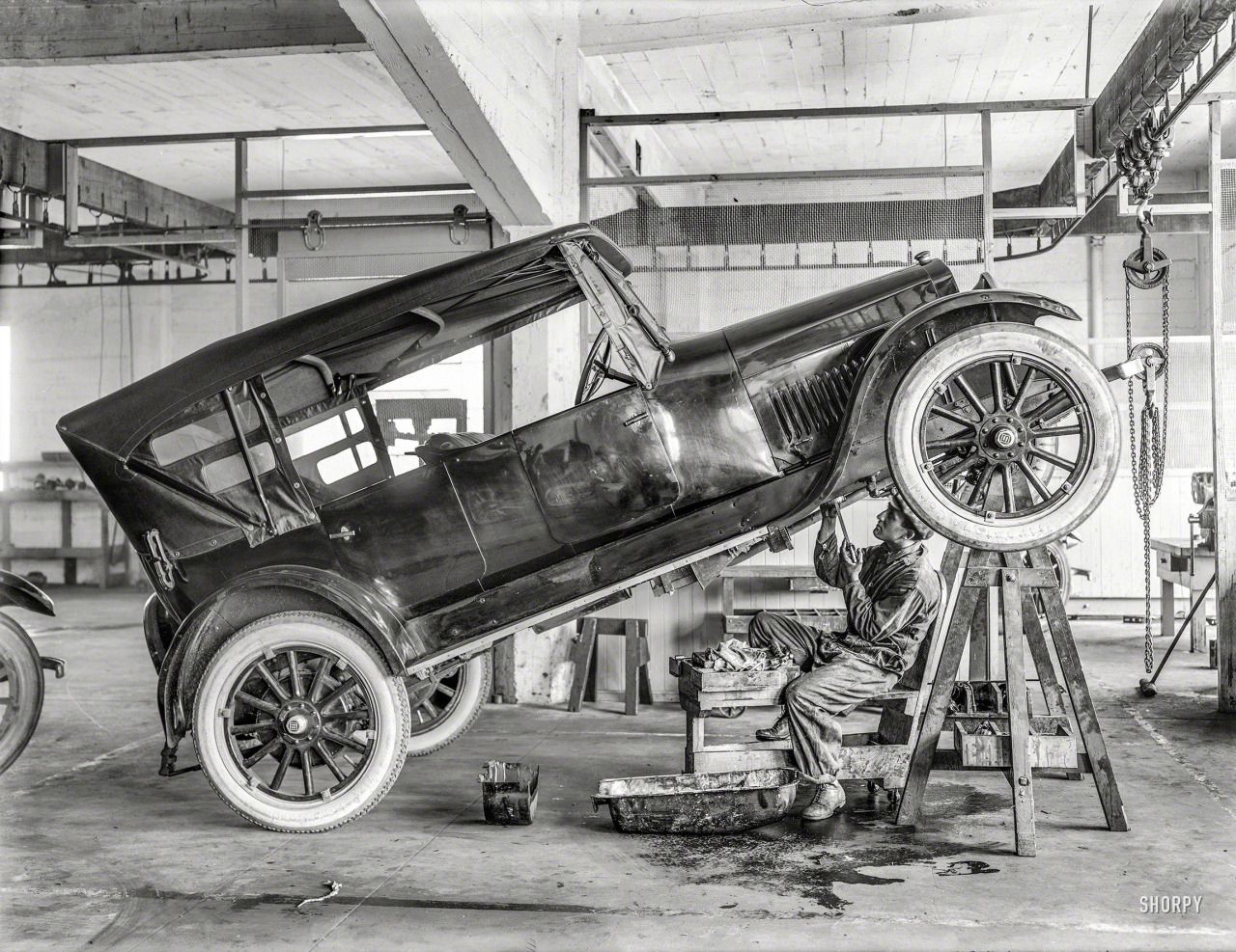 Mechanic working on an old Studebaker in repair shop-C.1919 | That\'s ...