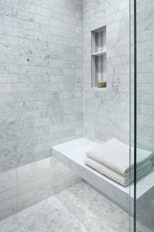 carrera marble floating shower bench with custom lighting bathroom