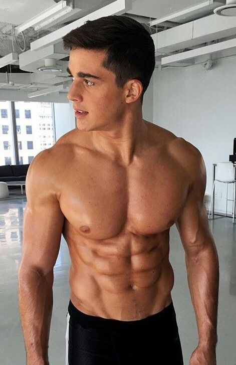 Young hunk with six pack abs consider