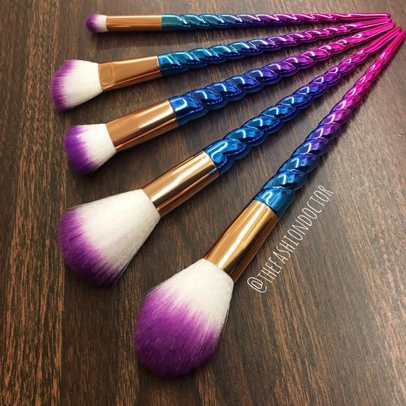 unicorn makeup brushes uses. pink ombré unicorn horn brushes. the bristles are made out of white and purple tipped synthetic hairs, perfect for use with powder makeup products. brushes uses