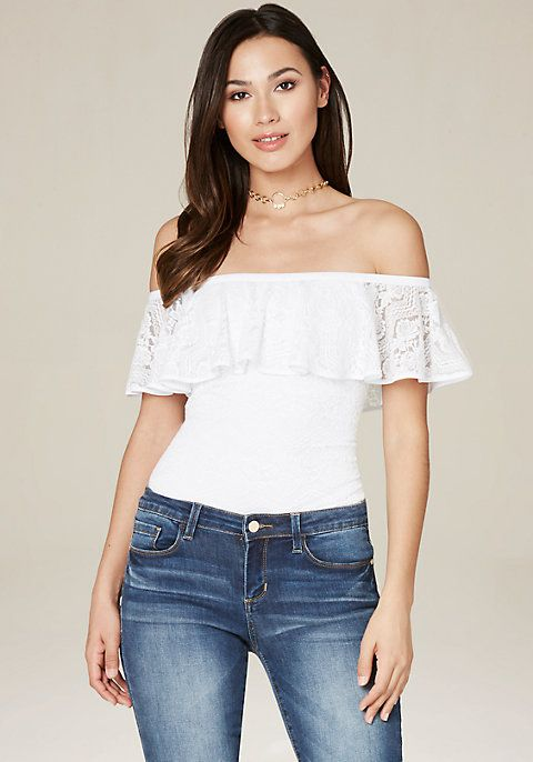 Sultry off-shoulder lace top sweetened by a pretty ruffle. Partially lined.