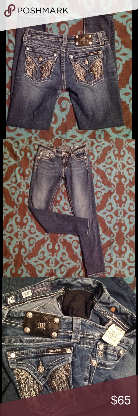 """Miss me skinny jeans fallen angel wings dark wash Miss me skinny jeans. Dark wash (sorry my photo quality isn't the best because of the lighting) . Size 29 inseam 32"""". Bling on pockets with fallen angel wing design. Good preowned condition. Miss Me Jeans Skinny"""