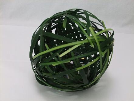 Weave a grass ball.