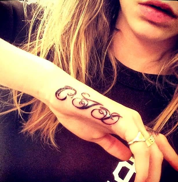 ebbe2bf43 Once Cara Delevingne got her first taste of a tattoo with the impressive  lion ink on her finger, there was no stopping her. Just one week after  commissioni