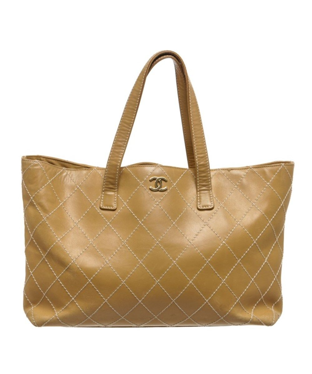 ad0afcb207d9 CHANEL Pre Owned - Chanel Beige Quilted Leather Surpique Stitch Large Tote  Bag'. #chanel #bags #leather #hand bags #tote #