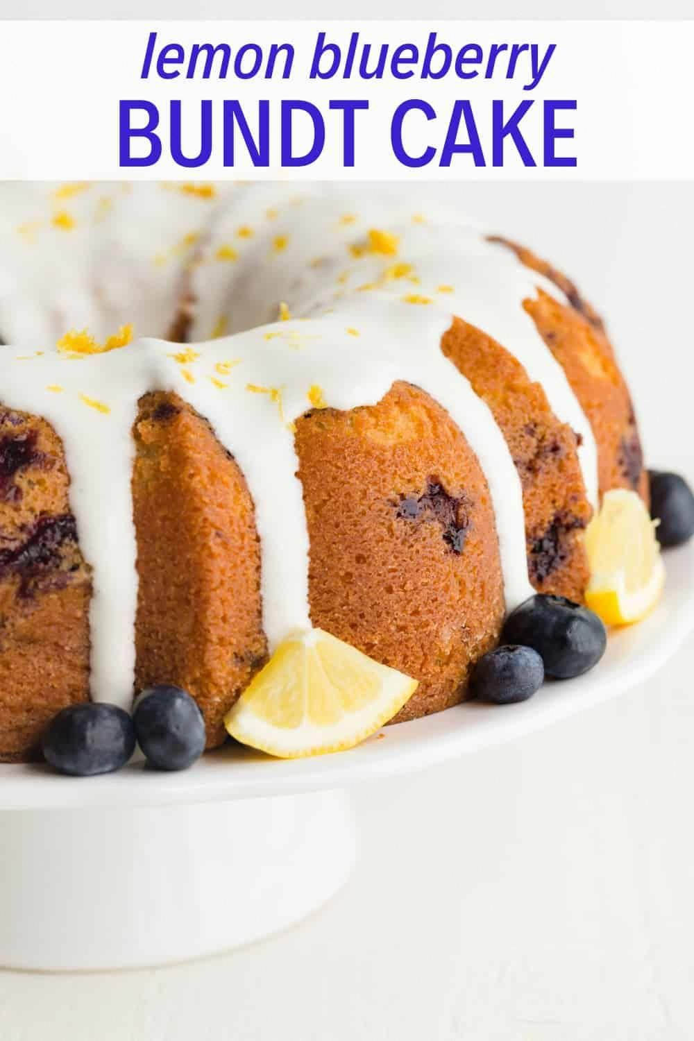 A classic lemon bundt cake speckled with fresh blueberries and topped with lemon cream cheese glaze