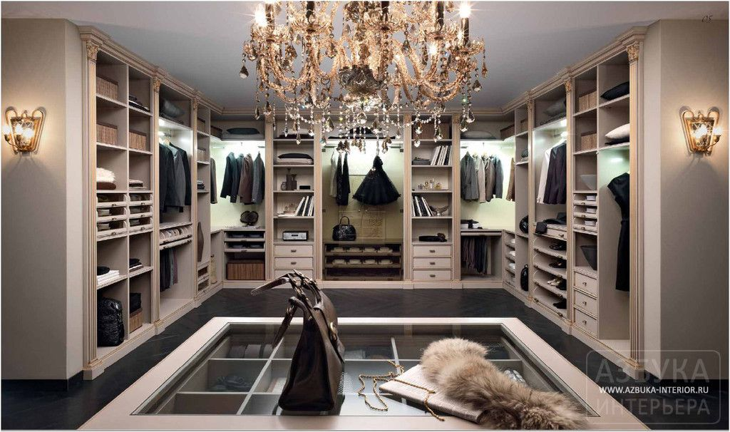 Dream Walk In Closet Complete With Custom Built Ins And Chandelier