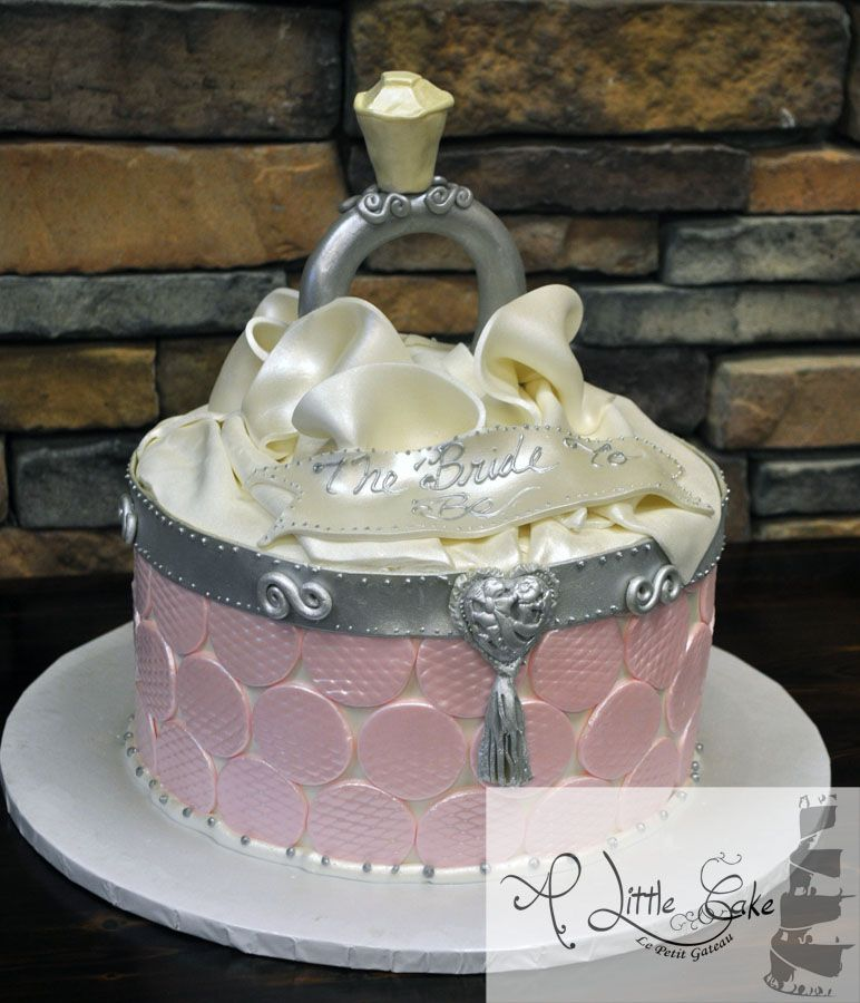 this beautiful bridal shower cake was made to look like an open ring box the