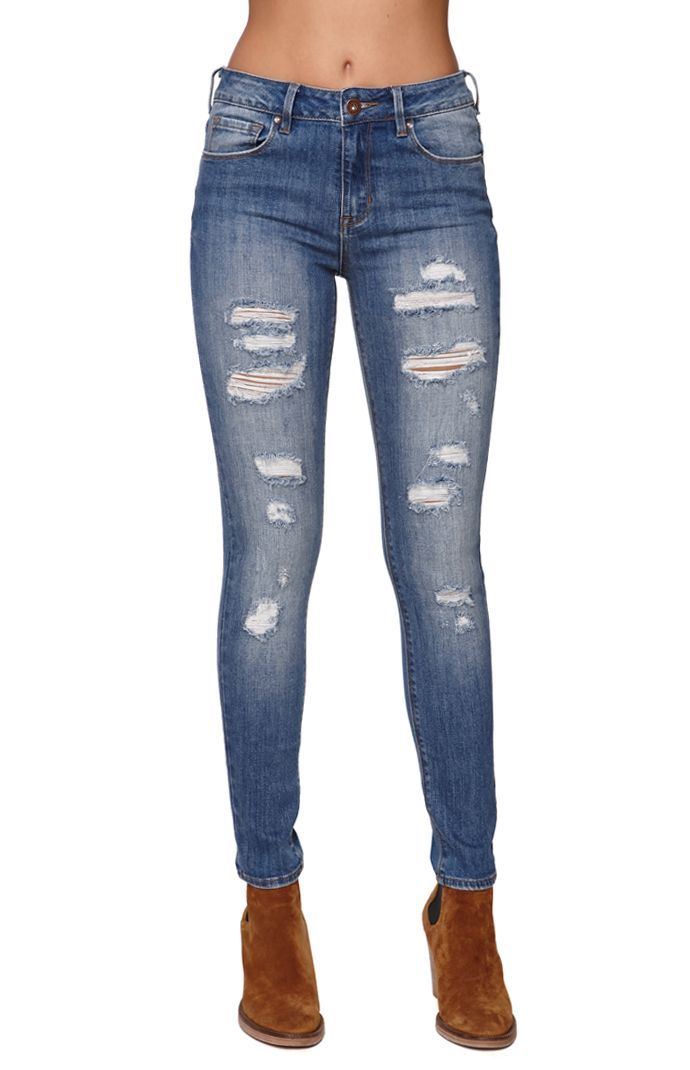 The women's High Rise Skinniest Cerulean Tide Jeans by Bullhead Denim Co  offer a distressed wash