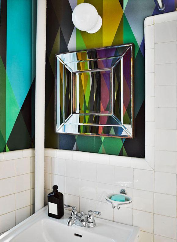 Splendor in the Bath. Cole & Son's Circus wallpaper and a concave mirror.NYC Home of Marie-Hélène de Taillac.