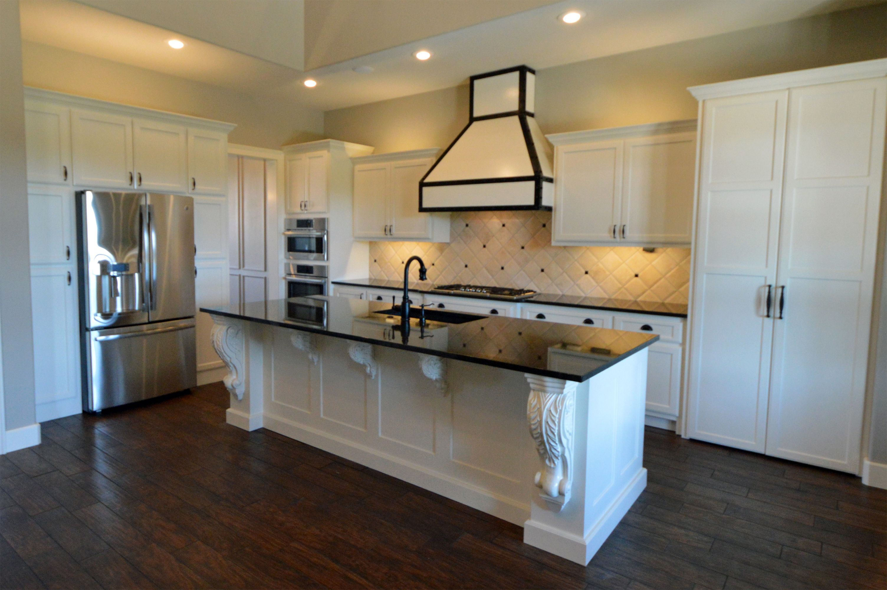 Open Kitchen Plan With Large Island Custom White Cabinets