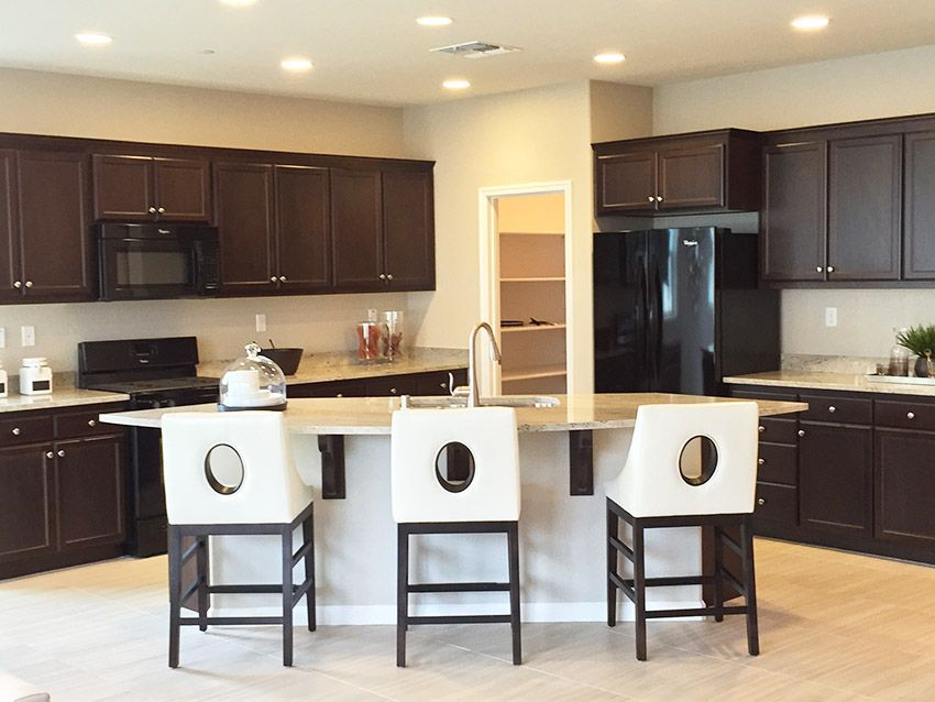 Brown And White Kitchen Ideas Part - 21: Dark Brown Cabinet Kitchen With A White Island And Light Color Granite  Counter.