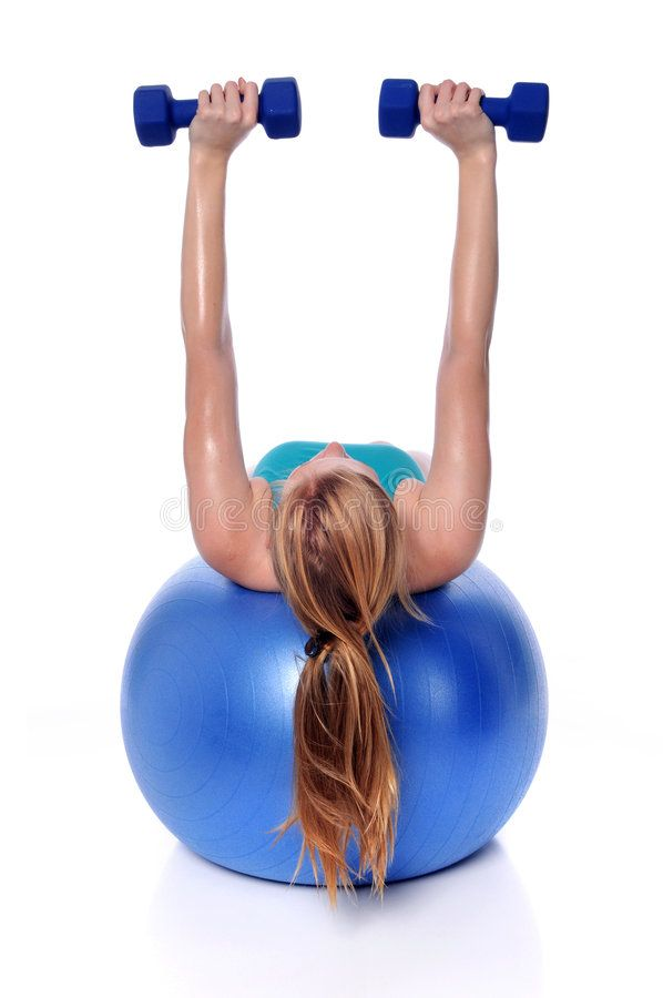 Woman Excercising On Fitness Ball. Young woman exercising with dumbbells laying , #Ad, #Ball, #Young...
