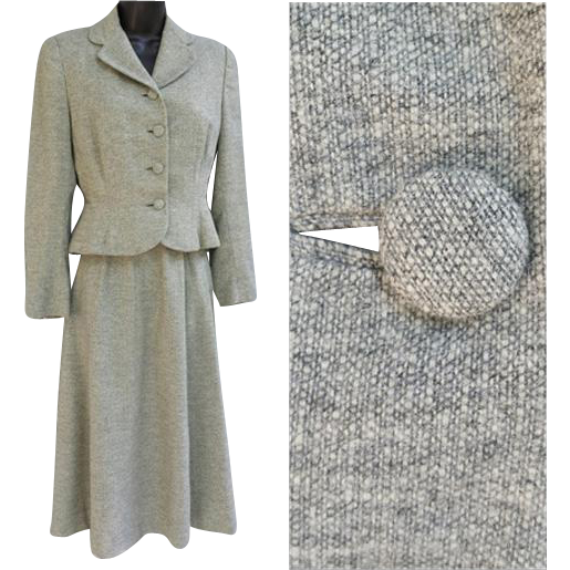 Beautifully tailored women's 1940s wasp waist suit in gray tweed size medium and mint condition. Offered at an introductory Sale Price for a short