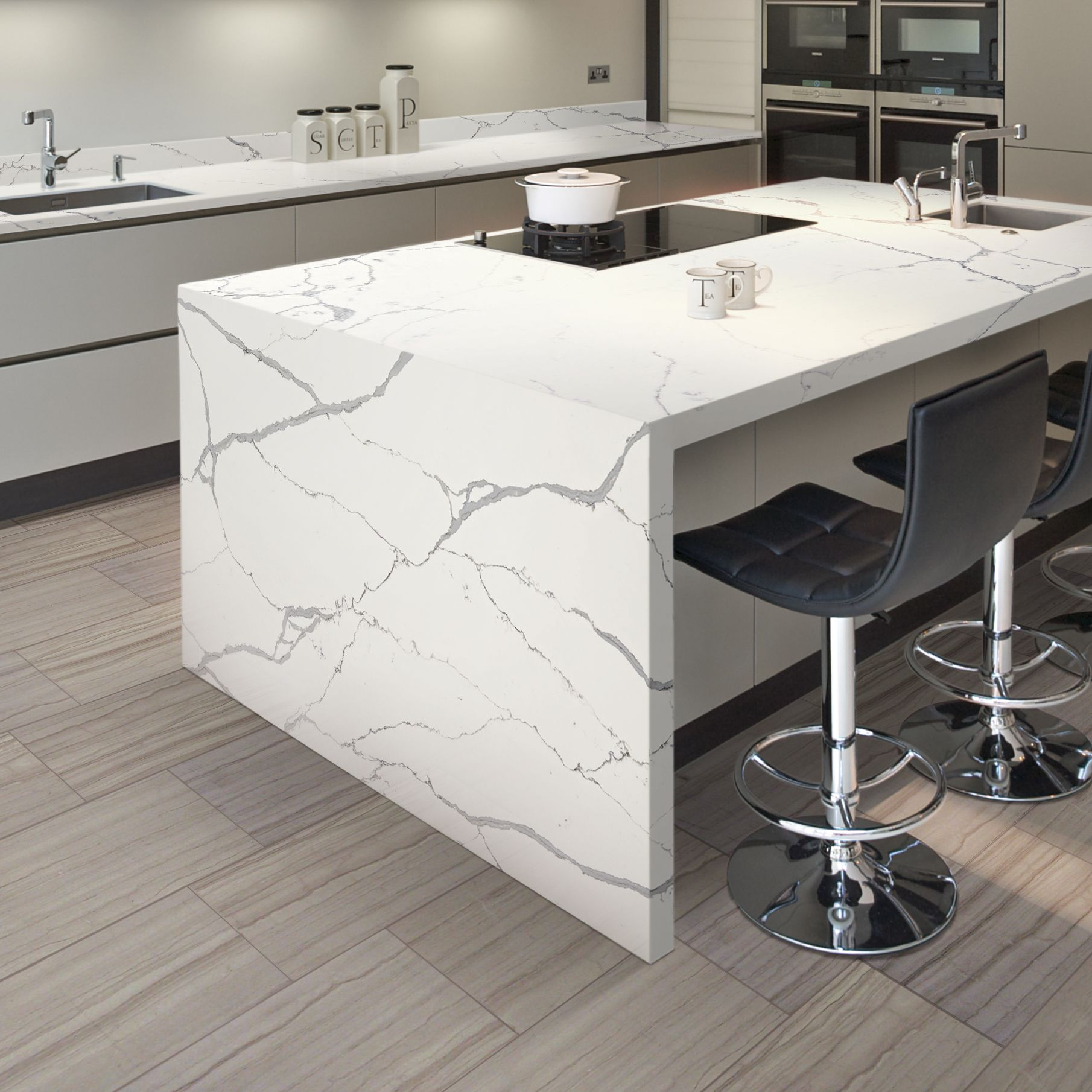 Photo features ONE Quartz Surfaces in Statuary Quartz on the counter and  Daltile Marble in Silver