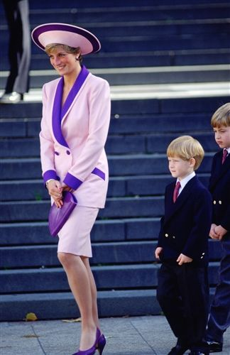 Accompanied by her sons, Princes Harry and William, Diana attends a special service for fire brigade veterans at St. Paul's Cathedral in 1990.