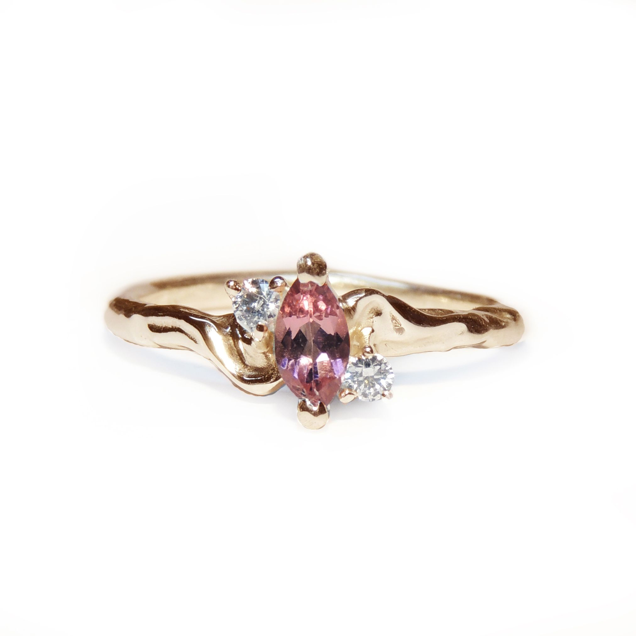 Handmade solid 9ct yellow gold ring set with a beautiful marquise tourmaline and two white diamond. The ...
