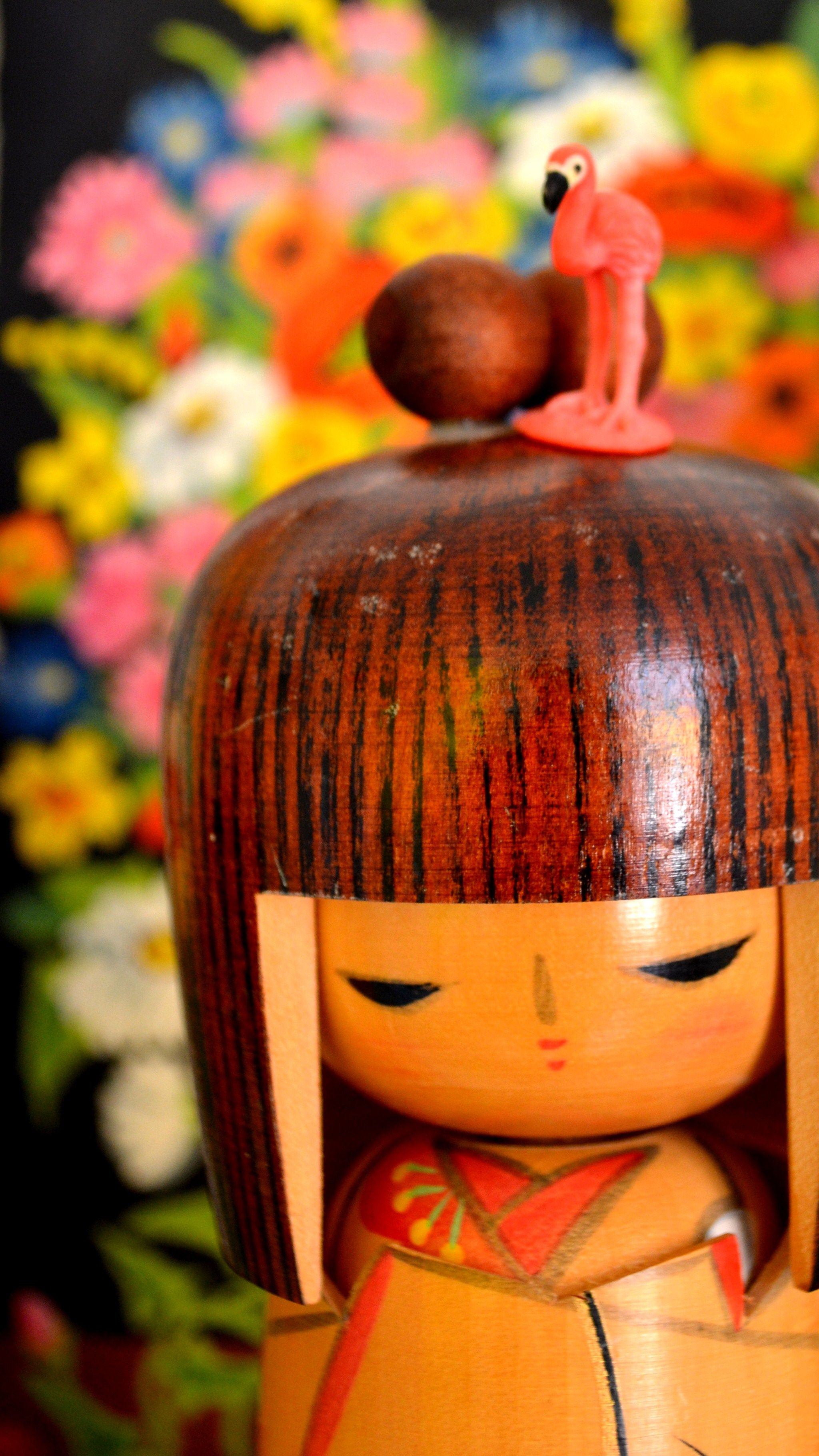 wooden Japanese doll (with flamingo)