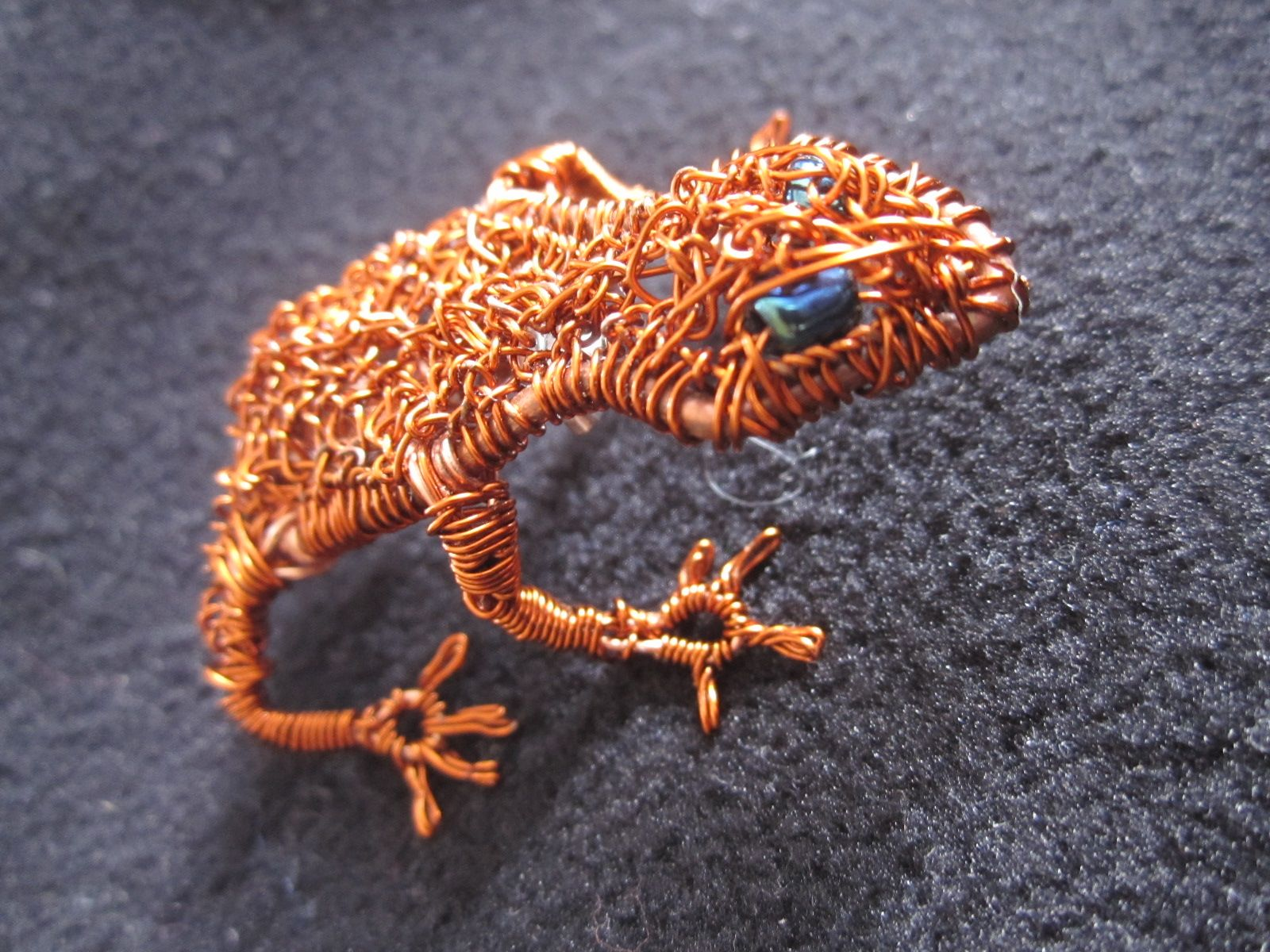 A copper frog made from recycled copper from a TV.