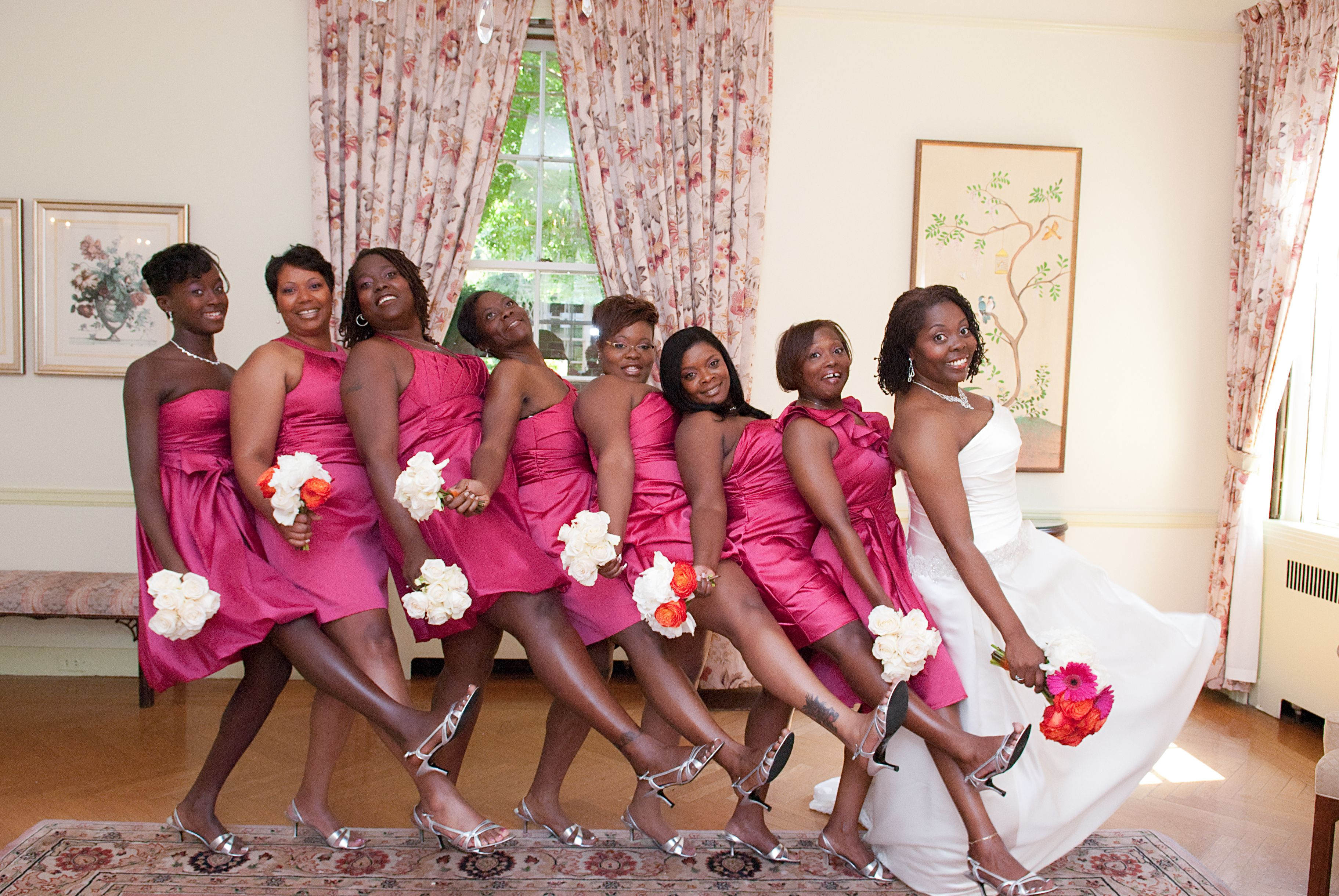 Wedding dresses for black girls  Black bridesmaids dresses with red rose bouquet  African American