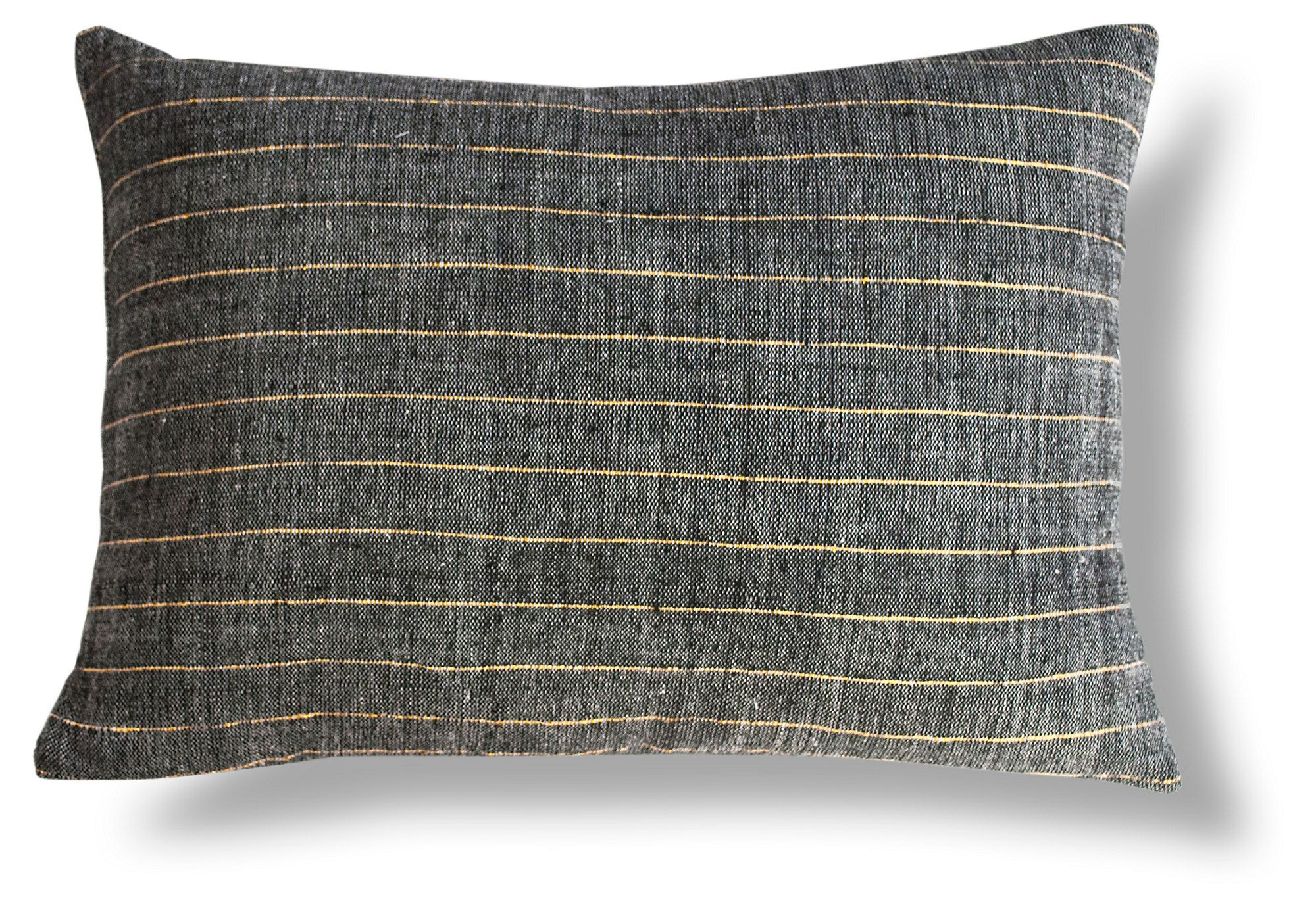 Made with a white warp, black weft, and gold stripes, this Ethiopian cotton pillow has a unique heathered look. Use it to add contrast and a little sparkle to any space. Insert included.