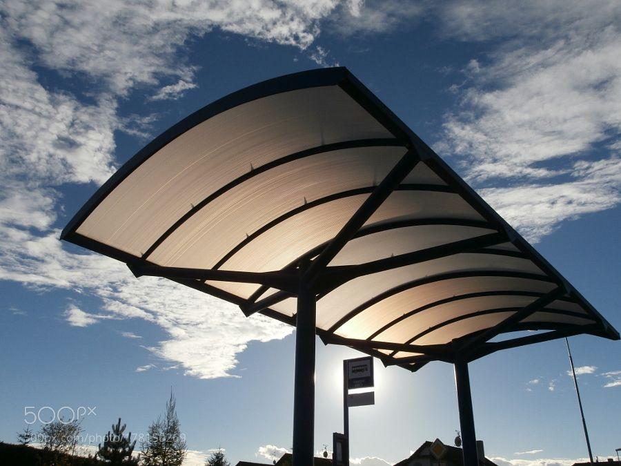 Roof of bus stop lit by evening sun by PandaWild with sunsunshinestoproofeveningwaitingstationbustransparentshinelit