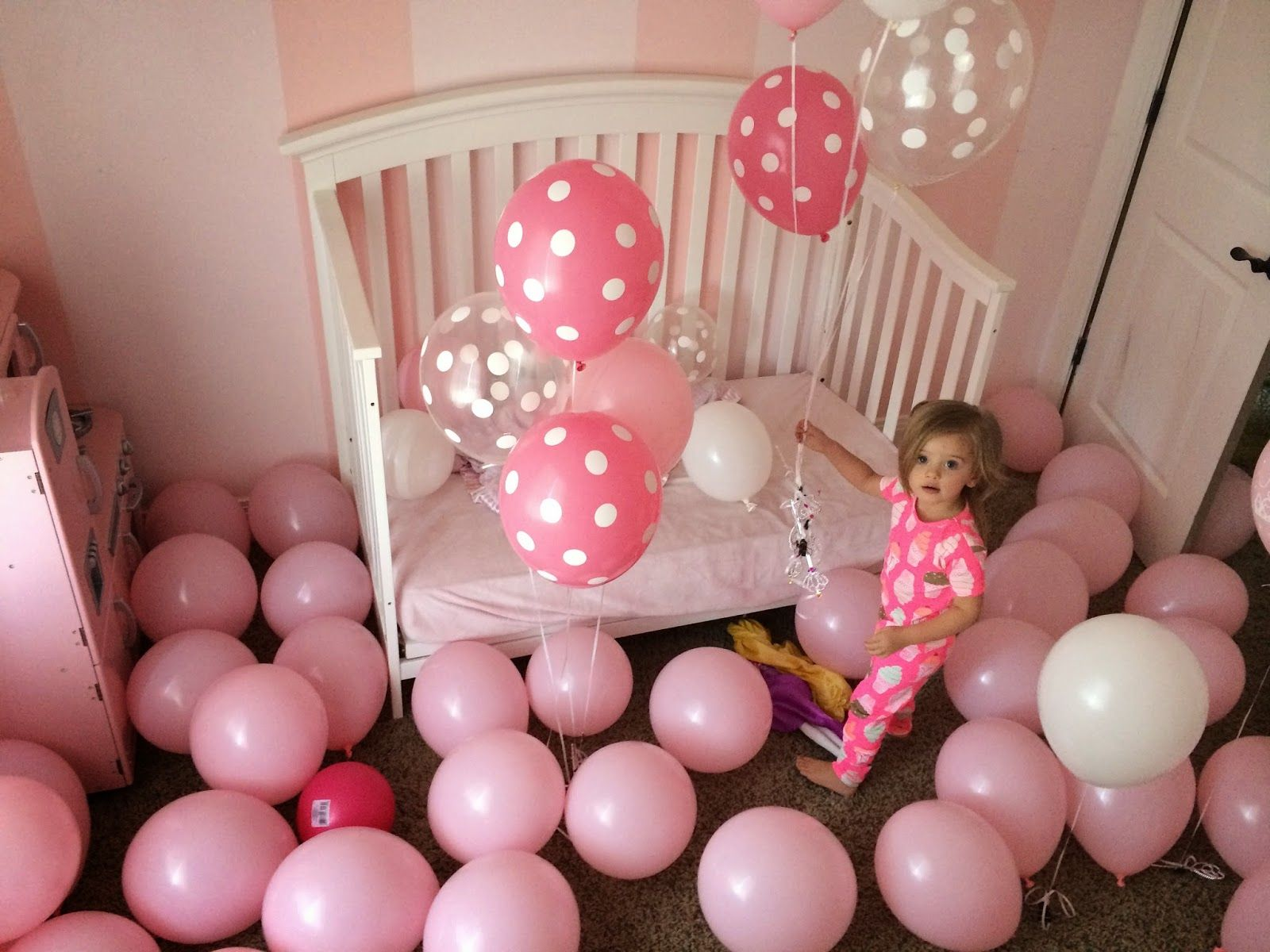 fill a toddlers room with balloons to wake up to on their
