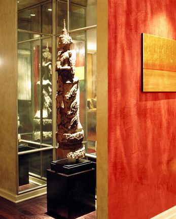Lake Shore Drive Condo- Foyer::Deb Reinhart Interior Design Group::red glazed walls, sculpture nook, mirror, asian artifacts