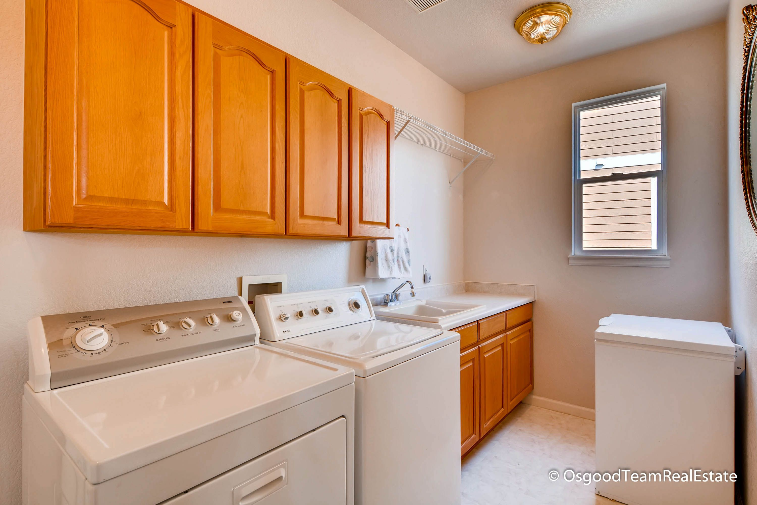Huge Laundry Room With Basin And Cabinets For Storage