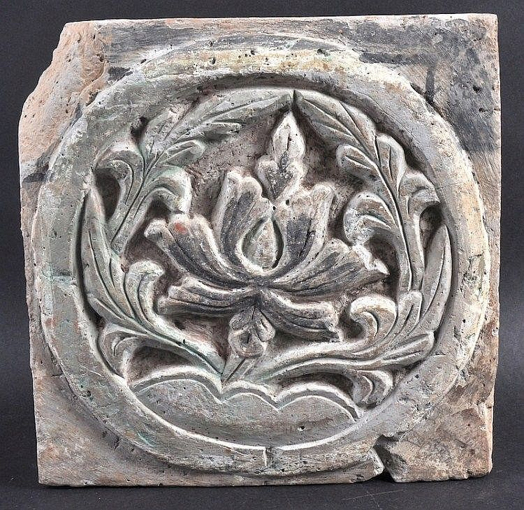 A 4TH CENTURY CHINESE POTTERY SQUARE TILE Jin Dynasty, decorated with a central floral roundel. 11 ins square.