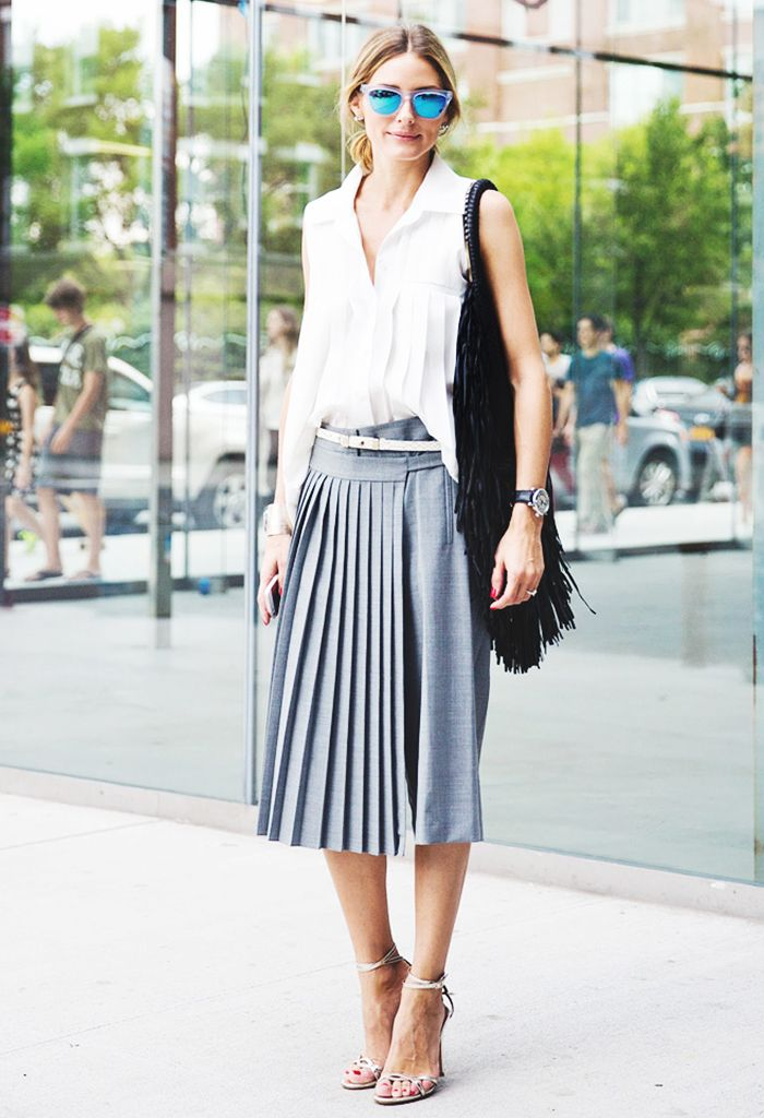 Olivia Palermo in a white sleeveless top and pleated midi skirt