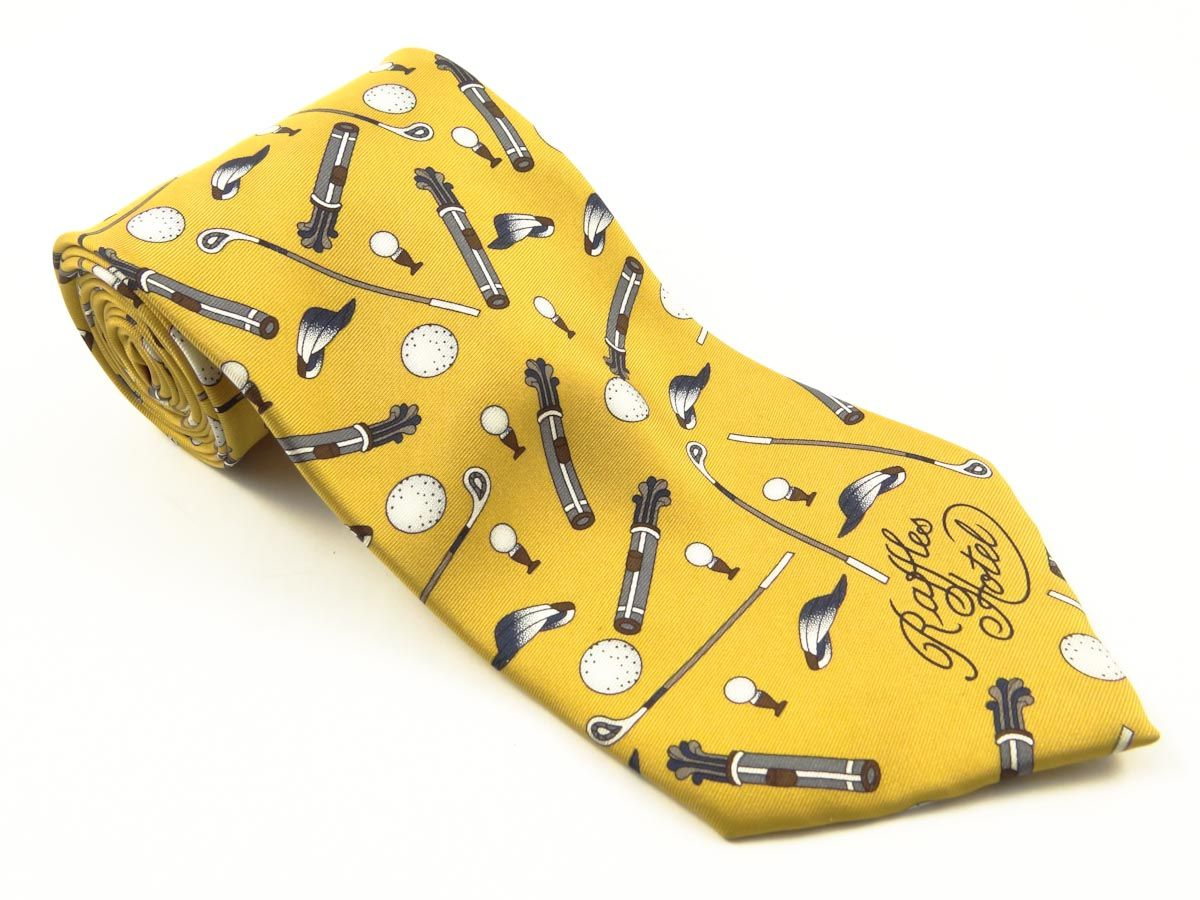 Raffles Hotels Logo Necktie. Quality : Printed Silk  Design Copy Rights Reserved. Sold By : Toss Marketing Pvt. Ltd.
