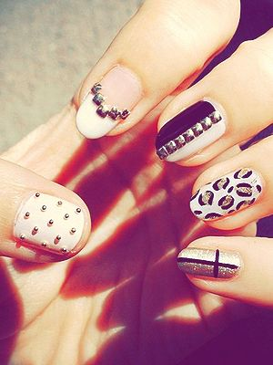 For a studded manicure, use tweezers to apply tiny studs to your nails while the topcoat is still wet, and mix up the patterns and polish colors for extra edge.
