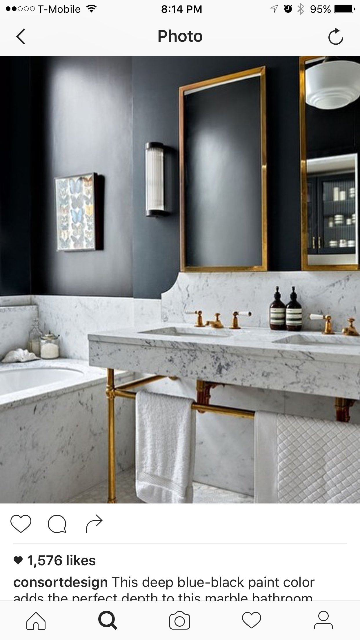 Marble Bathroom Suite with Marble Accents in Small Bathroom Ideas. Small  blue-black bathroom with marble suite, mirror and pendant light fitting.