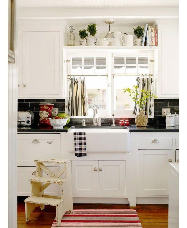 black countertops & tile w/ white cabinets; hardwood ...